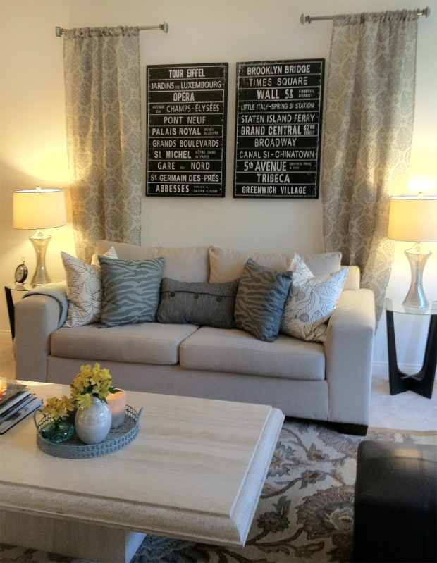 Sofa, drapes, art, and end tables.
